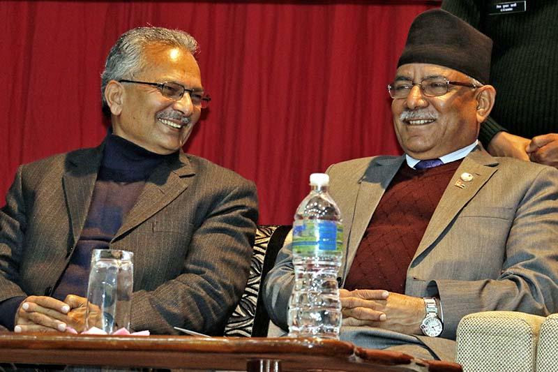 (Left) Naya Shakti Coordinator Baburam Bhattarai and Prime Minister and CPN Maoist Centre Chairman Pushpa Kamal Dahal, interact during the launch of 'Chacha', a book about the life of late Maoist leader Bhakti Prasad Pandey, in Kathmandu, on Monday, December 26, 2016. Photo: RSS