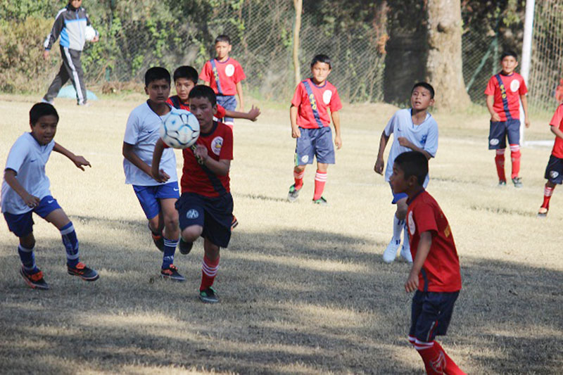 Action in the match between St Xavieru2019s Godavari (red) and St Xavieru2019s Jawalakhel during the 21st Fr Moran Memorial Inter-school Football Tournament in Lalitpur on Sunday, December 12, 2016.