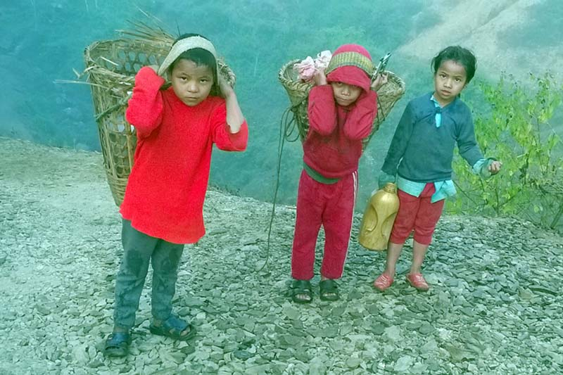 Children of Jharuwa, Musikot in Gulmi district ferry drinking water, on Thursday, December 22, 2016. Locals here are forced to walk farther for the want of water resources nearby. Photo: RSS