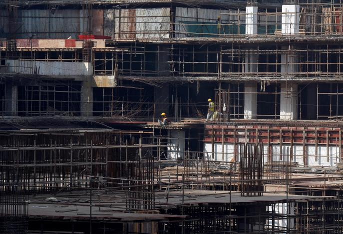 Construction workers work on a site of a residential building in Mumbai, India, November 30, 2016. REUTERS/Shailesh Andrade