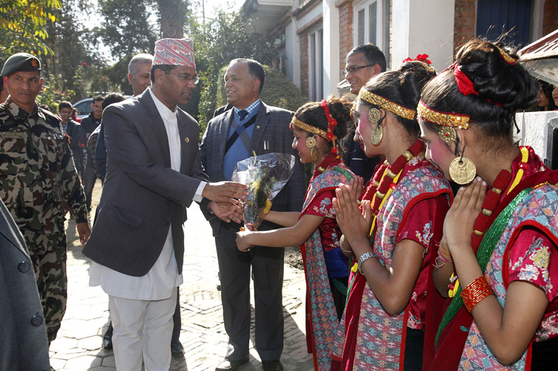Minister for Culture, Tourism and Civil Aviation Jeeban Bahadur Shahi being welcomed by students during the concluding function of mural arts painting workshop at Kanjirowa National School in Kathmandu on Wednesday, December 14, 2016. Photo: Kanjirowa National School