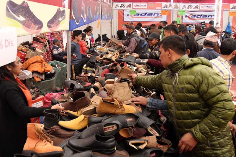 Members of the public visit a leather shoe exhibition in Bhrikutimandap of Kathmandu, on Sunday, December 11, 2016. Photo: RSS