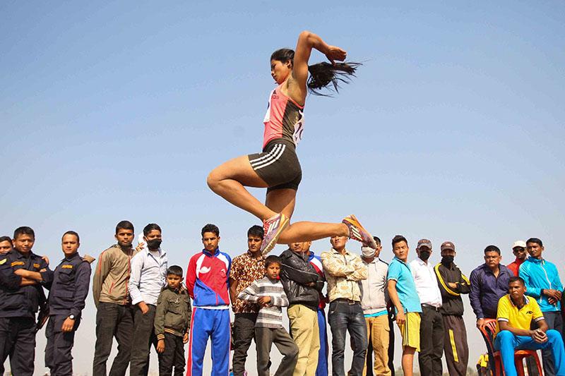 Keshari Chaudhary of Nepal Police Club competes during the womenu2019s long jump event at the Itahari Stadium in Sunsari on Sunday, December 25, 2016. Photo: Udipt Singh Chhetry/THT