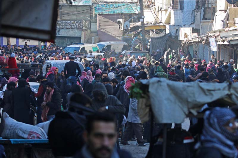 People gather to be evacuated from al-Sukkari rebel-held sector of eastern Aleppo, Syria, on Thursday, December 15, 2016. Photo: Reuters