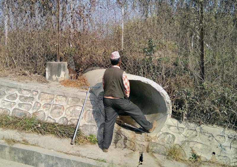 A man relieves himself in open at koteshwor. Photo: THT