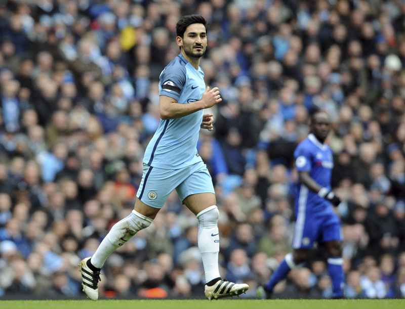File - Manchester City's Ilkay Gundogan runs during the English Premier League soccer match between Manchester City and Chelsea at the Etihad Stadium in Manchester, England, on December 3, 2016. Photo: AP