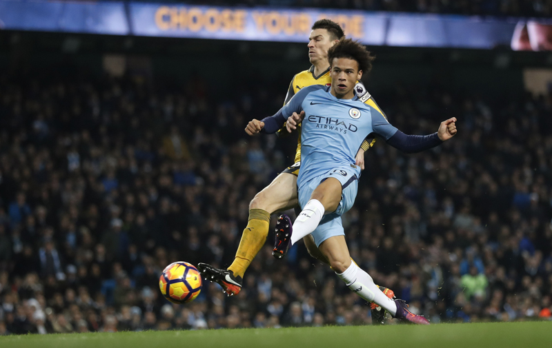 Manchester City's Leroy Sane scores their first goal. Photo: Reuters
