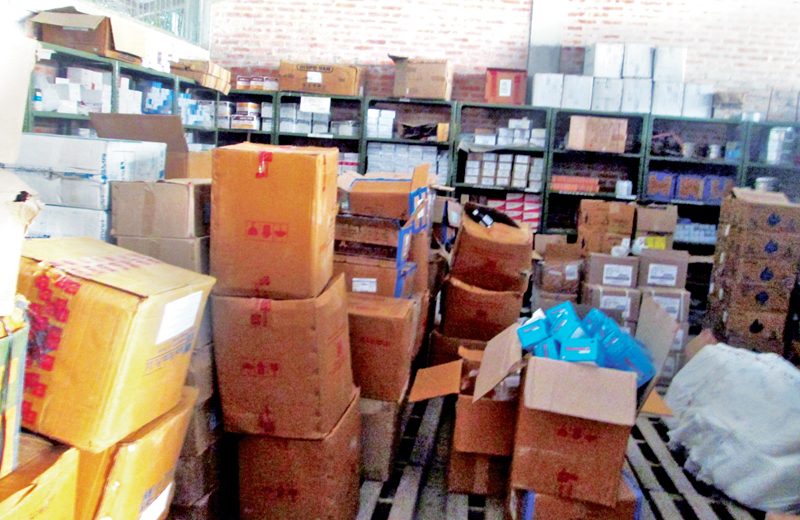 Recently procured drugs being stored randomly at District Health Office, in Damauli, Tanahun, on Monday, December 19, 2016. Photo: THT