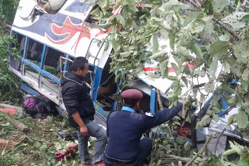 Police personnel try to rescue those injured in a bus accident in Myanglung of Terhathum, on Sunday, December 11, 2016. Photo: Sujan Nangleku