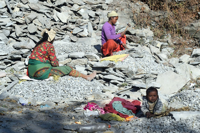 Women are seen crushing stones leaving their baby at Dandapani, Piple VDC in Myagdi district, on Monday, December 19, 2016. Photo: RSS