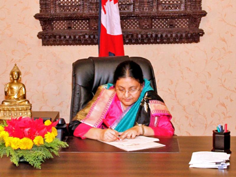 President Bidya Devi Bhandari approves a bill endorsed by the Legislature-Parliament, at her office, Sheetal Niwas, in Kathmandu, on Thursday, December 22, 2016. Photo Courtesy: President's Office