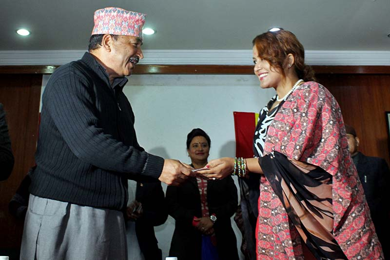 Rastriya Prajatantra Party Chairman Kamal Thapa welcomes actress Rekha Thapa to the party amid a programme organised in Kathmandu, on Monday, December 12, 2016. Photo: RSS