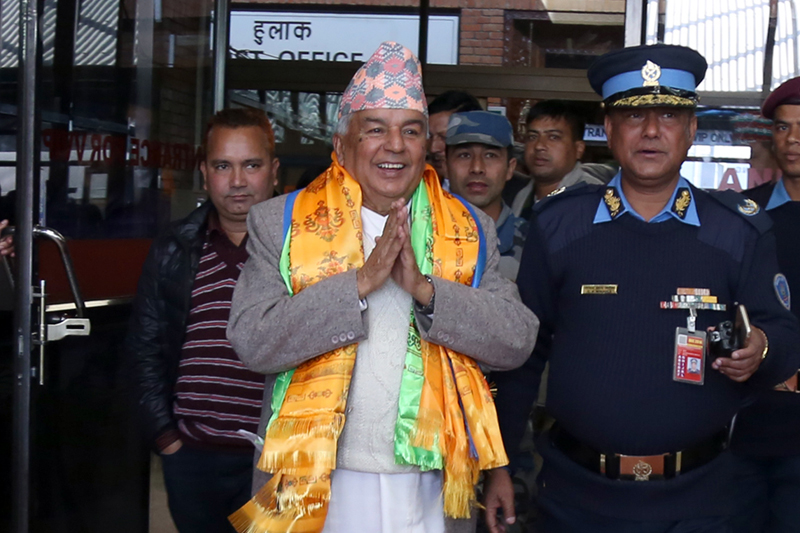 Nepali Congress senior leader Ram Chandra Paudel greets his supports as he arrives at the Tribhuvan International Airport in Kathmandu from Japan, on Wednesday, December 7, 2016. Photo: RSS