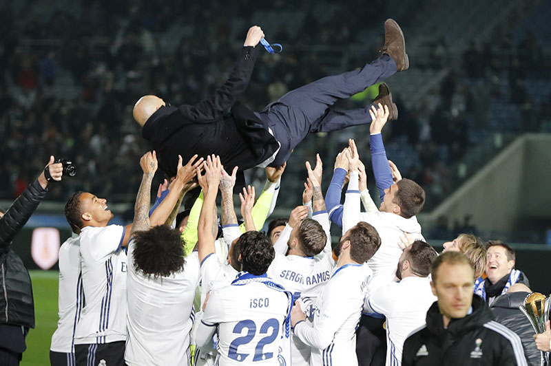 Real Madrid's head coach Zinedine Zidane is tossed into the air in celebration after his team won the final against Kashima Antlers at the FIFA Club World Cup soccer tournament in Yokohama, near Tokyo, on Sunday, December 18, 2016. Photo: AP