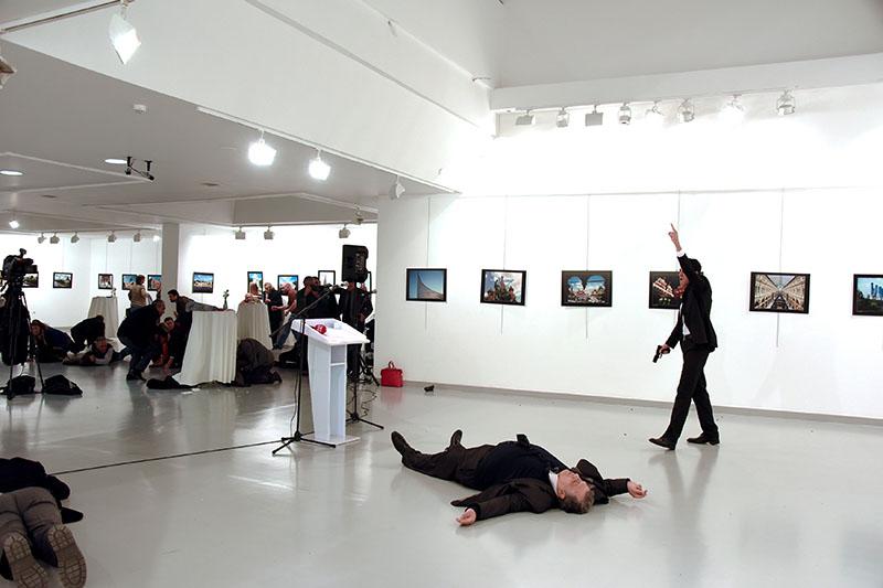 Russian Ambassador to Turkey Andrei Karlov lies on the ground after he was shot by Mevlut Mert Altintas at an art gallery in Ankara, Turkey, on December 19, 2016. Photo: Sozcu Newspaper via Reuters