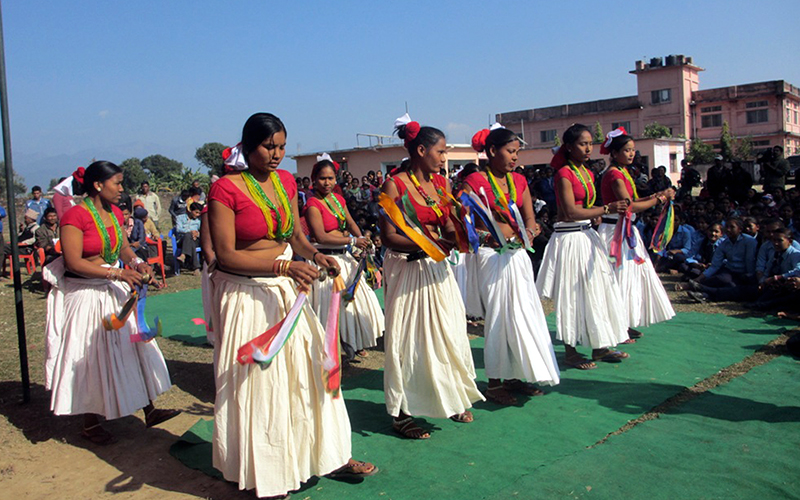 Local Tharu women of Krishnapur Municipality in Kanchanpur district perform the traditional Sakhiya dance after the Municipality was declared open defecation free zone in the district, on Friday, December 23, 2016. Photo: RSS