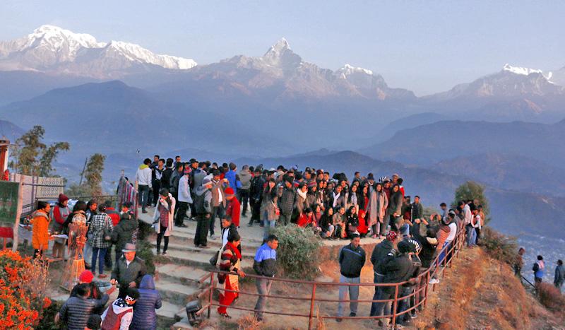 Tourists are seen enjoying the sunrise in the bosom of Annapurna Mountain Range, at Sarangkot, in Pokhara, on Sunday, December 25, 2016. Photo: RSS