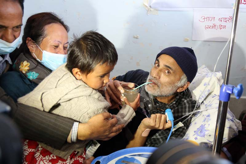 Tribhuvan University Teaching Hospital's senior orthopaedic surgeon Dr Govinda KC sips juice from the hands of a child as he ends the 22-day fast-unto-death, in Kathmandu, on Sunday, December 4, 2016. Photo: RSS
