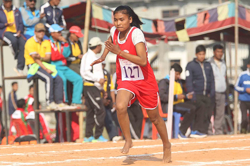 Sima Kumari Chaudhary of Far-western Regions runs without spike during the women's 800m race heats at the seventh National Games in Itahari on Sunday, December 25, 2016. Photo: Udipt Singh Chhetry/THT