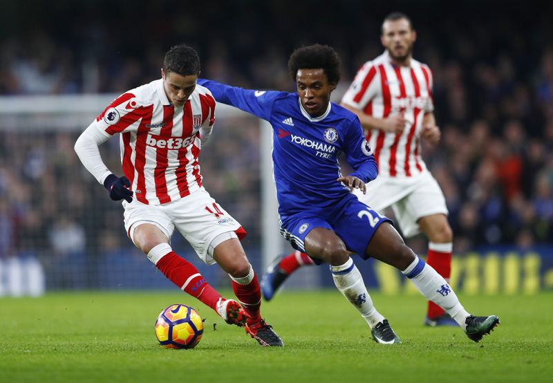 Stoke City's Ibrahim Affelay in action with Chelsea's Willian. Photo: Reuters