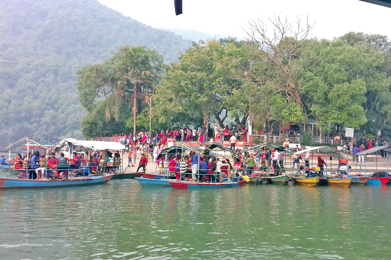 Tourists boat to pay a homage to the Tal Barahai Temple, at the centre of Phewa Lake, in Pokhara of Kaski, on Friday, December 30, 2016. Photo: RSS