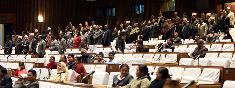 Lawmakers of the main opposition CPN-UML and other opposition parties stand up from their seats as they obstruct the Parliament meeting against the Constitution amendment bill, on Friday, December 9, 2016. Photo: RSS