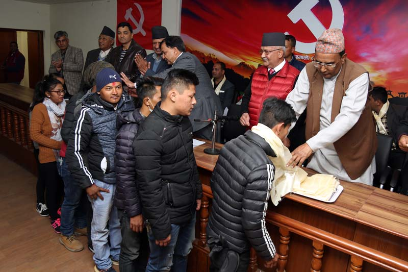 CPN-UML Chairman KP Sharma Oli among other leaders welcomes leaders and cadres of various parties after they defected to the main opposition, in Dhumbarahi of Kathmandu on Thursday, December 8, 2016. Photo: RSS