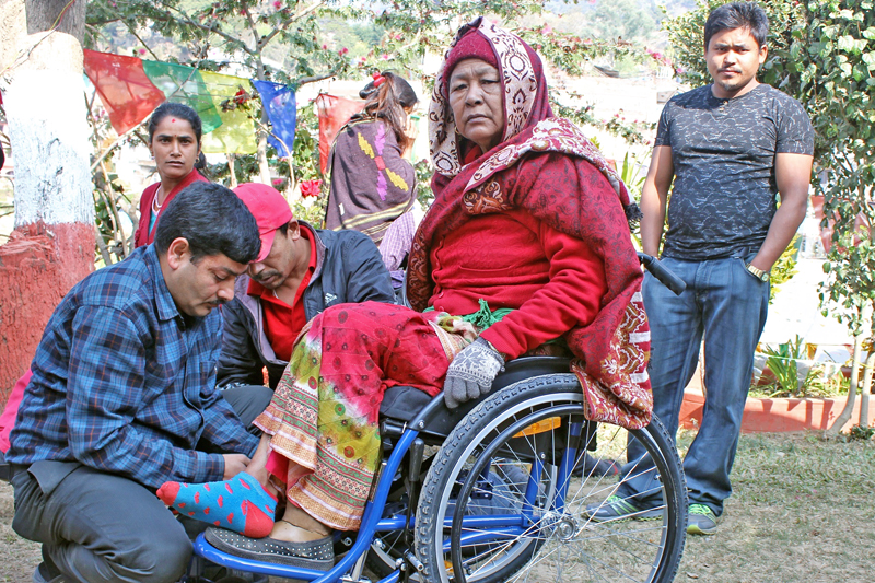 The National Disability Fund distributes wheelchairs to physically disabled persons in Gorkha district, on Monday, December 26, 2016. Photo: RSSn