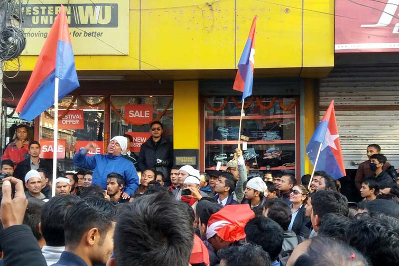 A leader of the CPN-UML-aligned Youth Association Nepal addresses the crowd gathered to protest the Constitution amendment bill, at Putalisadak, on Thursday, December 1, 2016. Photo: Monica Lohani/THT