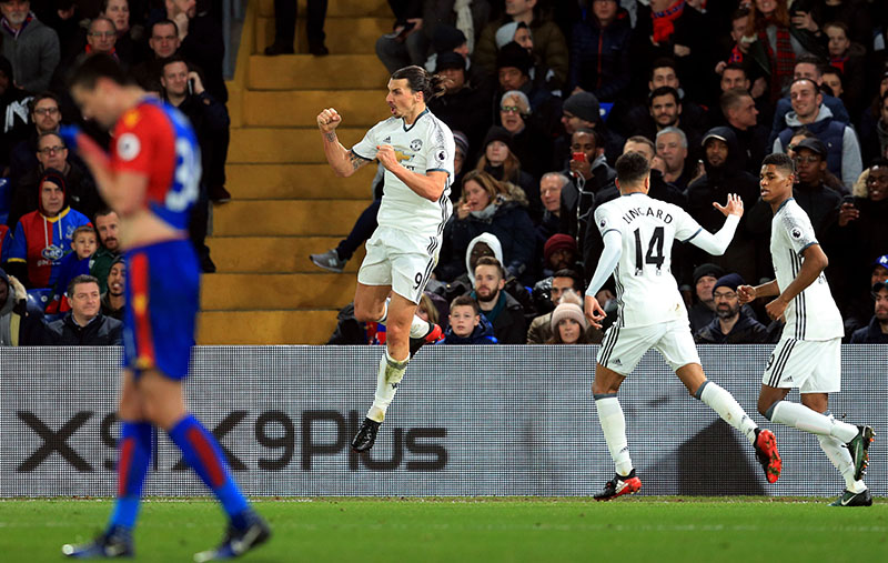 Manchester United's Zlatan Ibrahimovic celebrates scoring his side's second goal of the game against Crystal Palace during their English Premier League soccer match at Selhurst Park in London, on Wednesday, December 14, 2016. Photo: Adam Davy / PA via AP