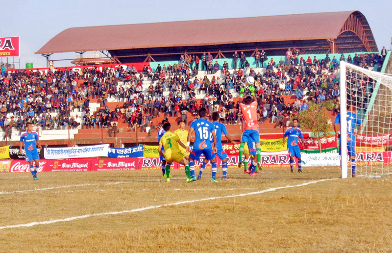 Nepal APF club goalkeeper tries to punch a ball against Dharan football club during the 15th Aaha Rara Football Tournament at the Pokhara stadium in Pokhara of Kaski district, on Wednesday, January 18, 2017. Photo: RSS