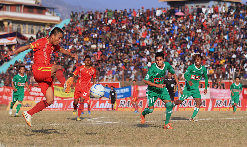 Players of Tribhuvan Army Club and Sahara Club (right) vie for the ball during their semi-final match of the 15th Aaha-Rara Gold Cup at the Pokhara Stadium on Wednesday, January 25, 2017. Photo courtesy: Yunish Gurung