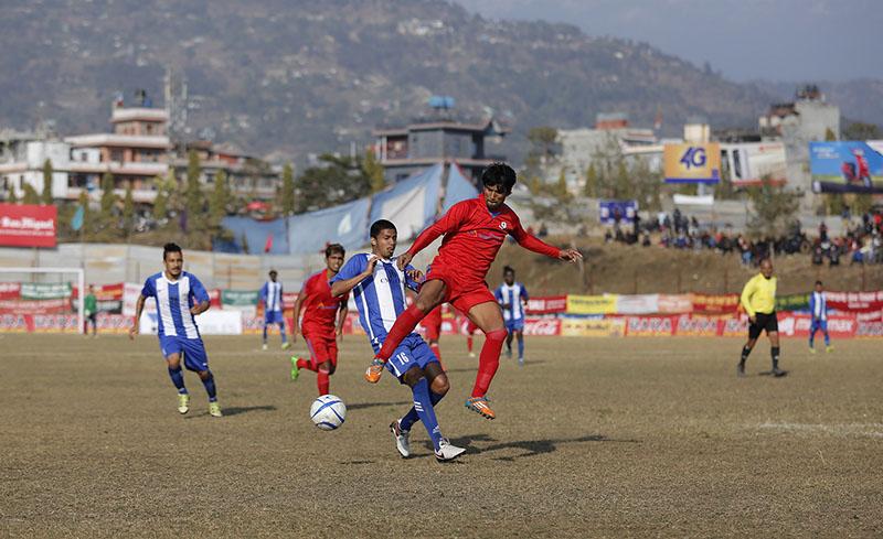 Saroj Dahal (left) of CMG Club Sankata vies for the ball with his Narayangunj FC opponent during their 15th Aaha-Rara Gold Cup quarter-final match at the Pokhara Stadium on Tuesday, January 24, 2017. Photo courtesy: Yunish Gurung