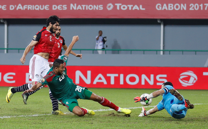 Egypt's goalkeeper Essam El Hadary saves the ball from Morocco's Aziz Bouhaddouz in the game. Photo: Reuters