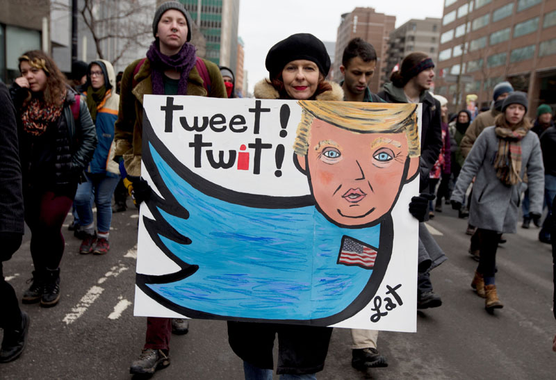 Anti-Trump protesters march in Montreal, Canada on January 20, 2017. Photo: Reuters