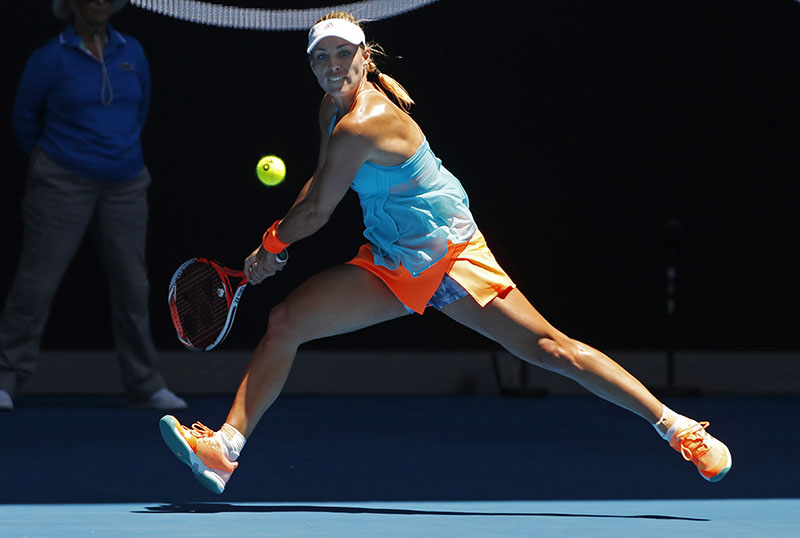 Germany's Angelique Kerber eyes on the ball for a backhand return to compatriot Carina Witthoeft during their second round match at the Australian Open tennis championships in Melbourne, Australia, on Wednesday, January 18, 2017. Photo: AP