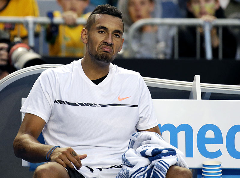 Australia's Nick Kyrgios reacts while sitting in his chair during his second round match against Italy's Andreas Seppi at the Australian Open tennis championships in Melbourne, Australia, on Wednesday, January 18, 2017. Photo: AP