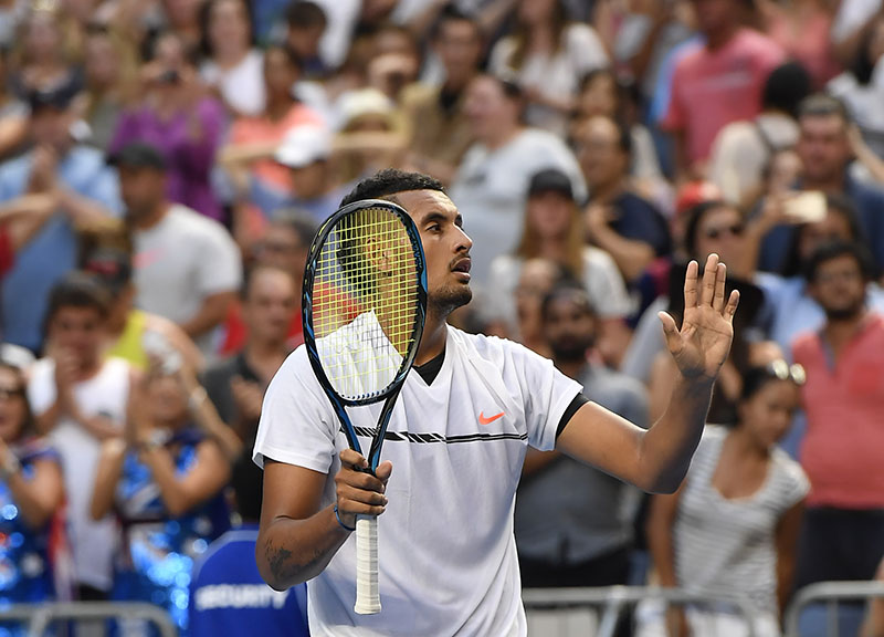 Australia's Nick Kyrgios waves to the crowd after defeating Portugal's Gasto Elias in their first round match at the Australian Open tennis championships in Melbourne, Australia, on Monday, January 16, 2017. Photo: AP