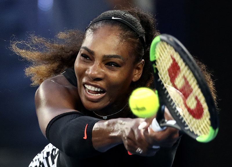 United States' Serena Williams makes a backhand return to her sister Venus during the women's singles final at the Australian Open tennis championships in Melbourne, Australia, on Saturday, January 28, 2017. Photo: AP