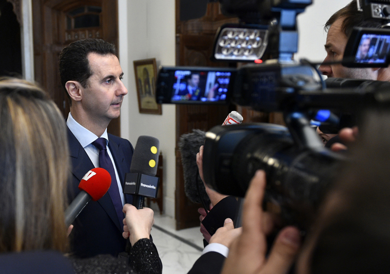 In this photo released Monday, Jan. 9, 2017 by the Syrian official news agency SANA, Syrian President Bashar Assad, left, speaks with French journalists in Damascus, Syria. Photo: AP