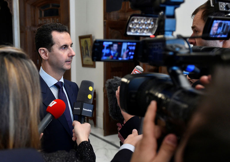 Syria's President Bashar al-Assad speaks to French journalists in Damascus, Syria, in this handout picture provided by SANA on January 9, 2017. Photo: Reuters