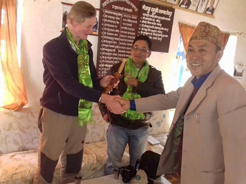 Bhojpur Multiple Campus Chief Rohit Kumar Shrestha presenting a Bhojpure Khukuri to GWS Nepalu2019s Director John White in Shresthau2019s office, in Bhojpur, on Monday, January 30, 2017. Photo: THT