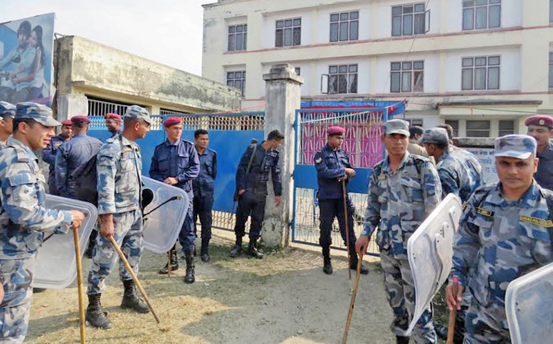 Police guarding the Parsa District Public Health Office in Birgunj after a clash erupted, on Wednesday, January 25, 2017. Photo: Ram Sarraf