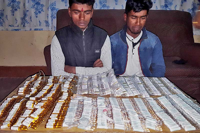 Police make two arrested youth, Ram Yadav and Pramod Yadav, public along with the contrabands seized from their possession, in Birgunj on Friday, January 6, 2017. Photo: Ram Sarraf/THT