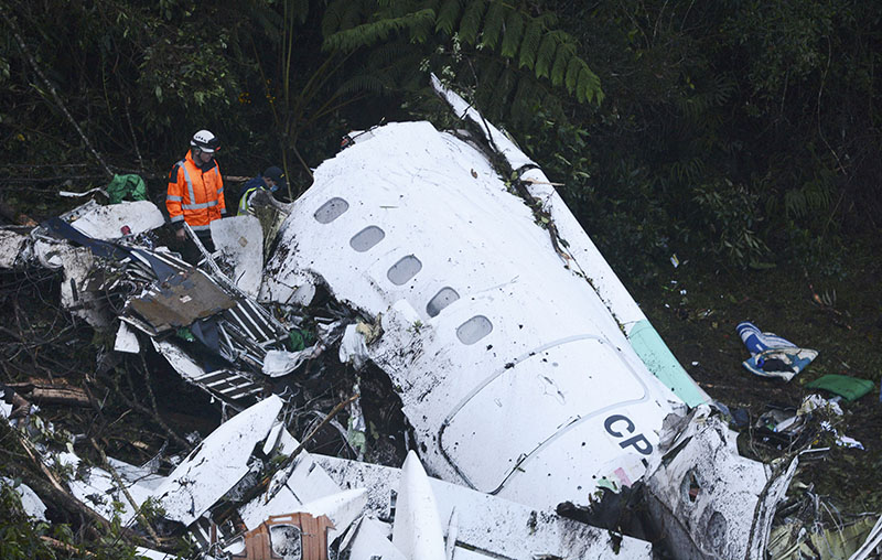 FILE - Rescue workers search at the wreckage site of a chartered airplane that crashed outside Medellin, Colombia, on November 29, 2016. Three players survived and 19 players perished in the air crash almost two months ago in Colombia. Photo: AP