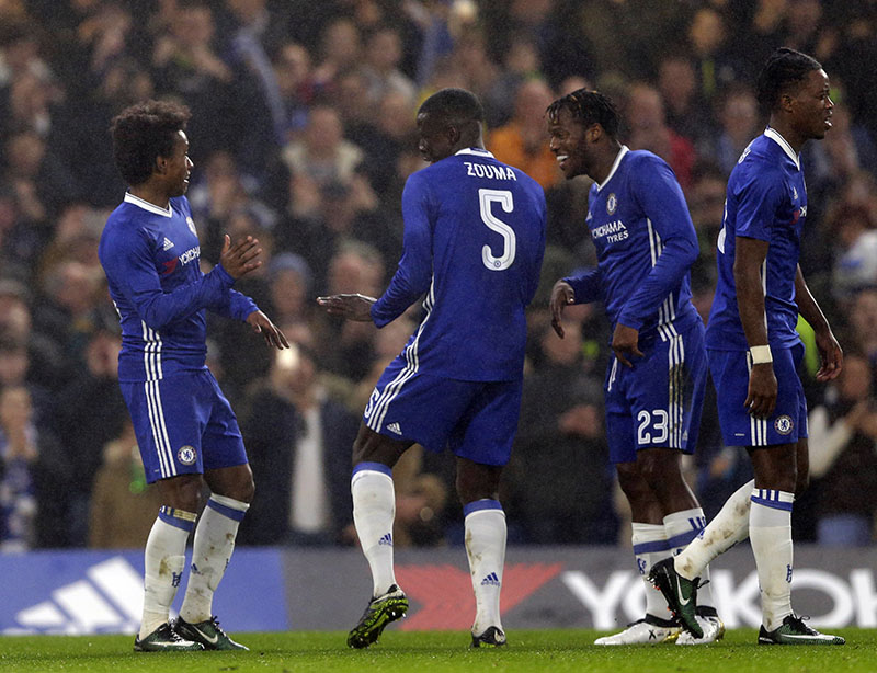 Chelsea's William (left) celebrates after scoring his side's third goal during the English FA Cup third round soccer match between Chelsea and Peterborough United at Stamford Bridge stadium in London, on Sunday, January 8, 2017. Photo: AP