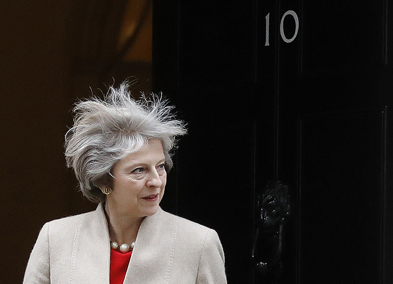 Britain's Prime Minister Theresa May looks out of 10 Downing Street as she wait for the arrival the Prime Minister of New Zealand Bill English at 10 Downing Street in London, on Friday, January 13, 2017. Photo: AP