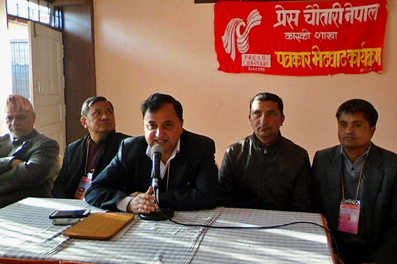 CPN-UML General Secretary Ishwar Pokhrel (centre) speaks at a press meet organised by the Press Chautari Nepal Kaski Chapter in the district, on Tuesday, January 24, 2017. Photo: RSS