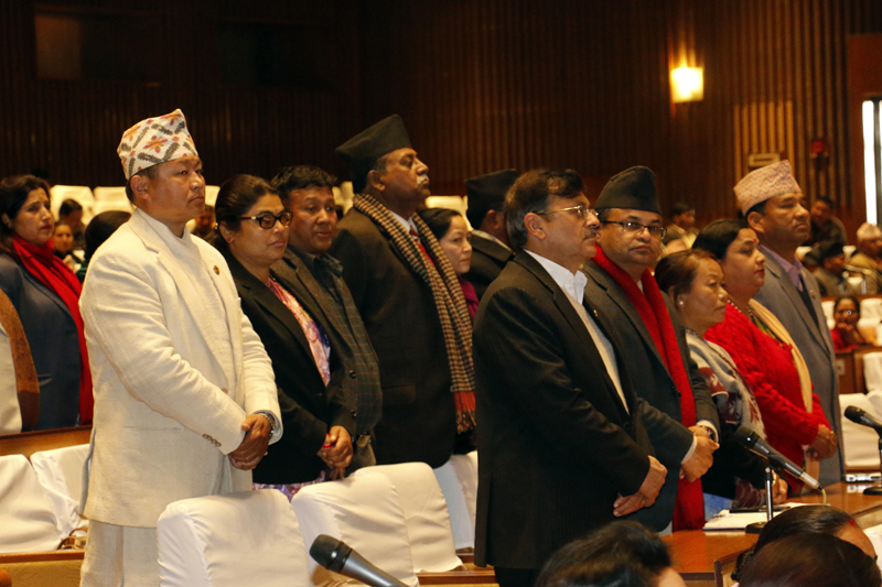 Lawmakers of the main opposition CPN-UML and other opposition parties stand up from their seats as they obstruct the Parliament meeting against the Constitution amendment bill, on Monday, January 2, 2017. Photo: RSS