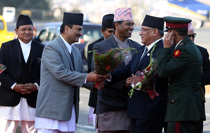 Chief Secretary Som Lal Subedi welcomes Prime Minister Pushpa Kamal Dahal at the Tribhuvan Interational Airport in Kathmandu upon his return from the United Arab Emirates on Tuesday, January 17, 2017. Photo: RSS